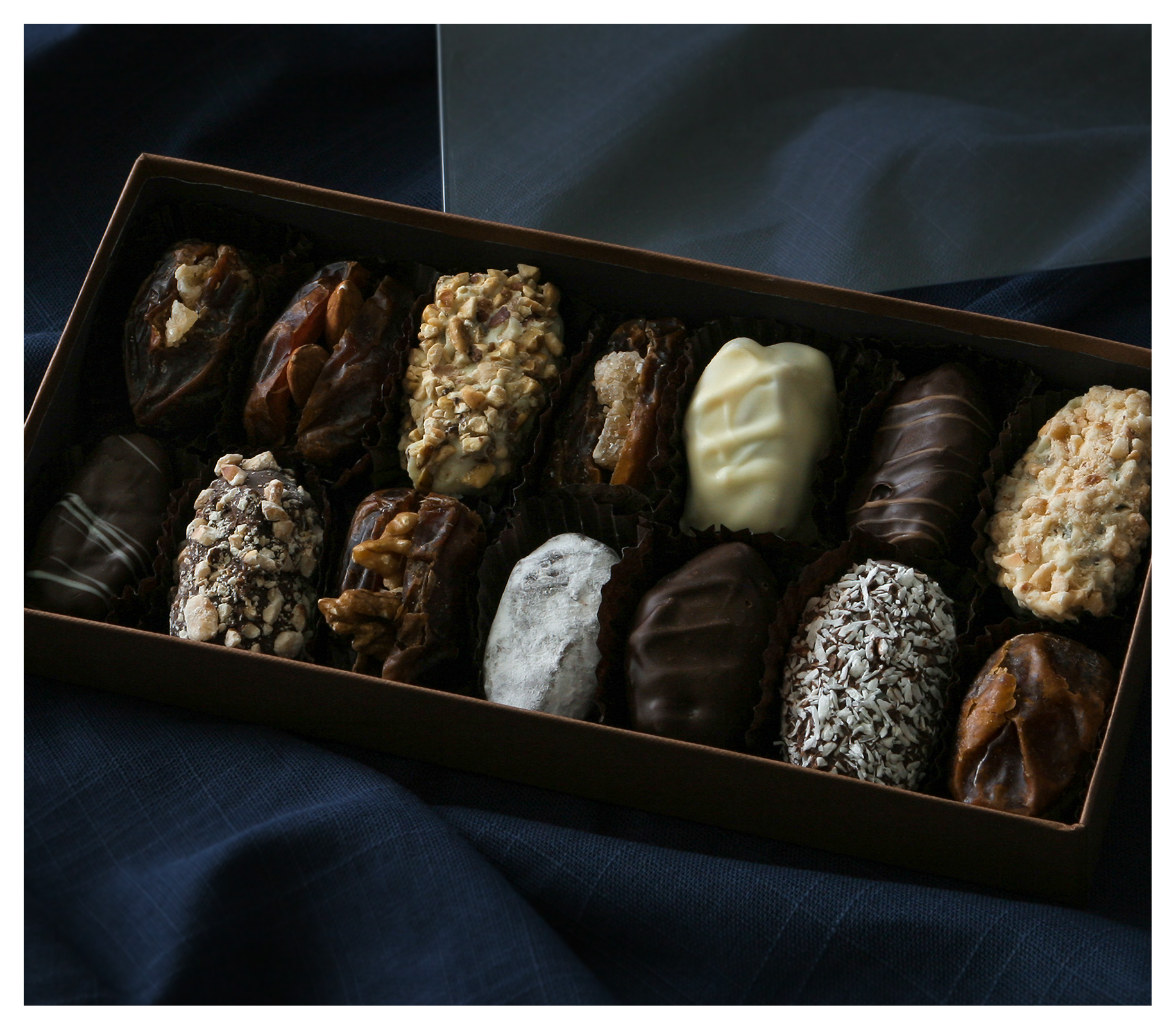 Food as product photography: Chocolate coated medjool dates in luxury gift box