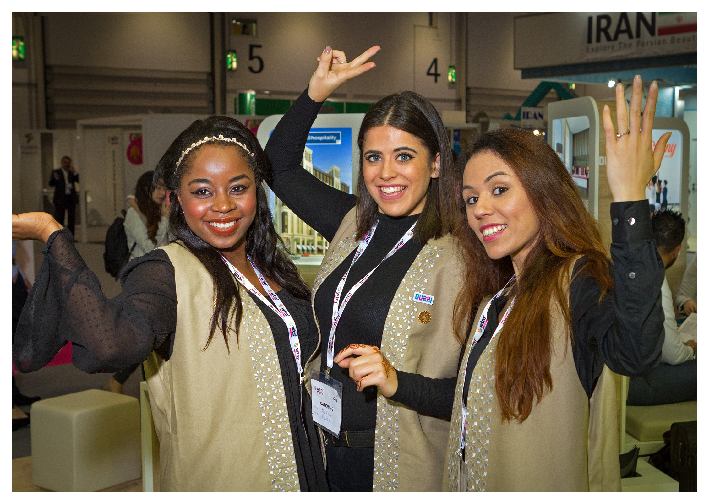 Editorial (portrait) photography: Cheerful hostesses at the Dubai stand, World Travel Market 2017, ExCel London