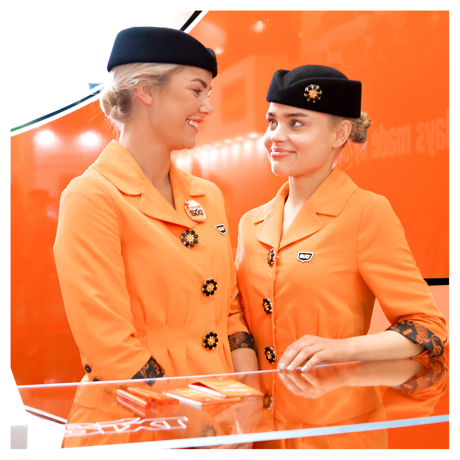 PR photography: Friendly exhibition hostesses for Sixt car hire, World Travel Market 2018, ExCel London