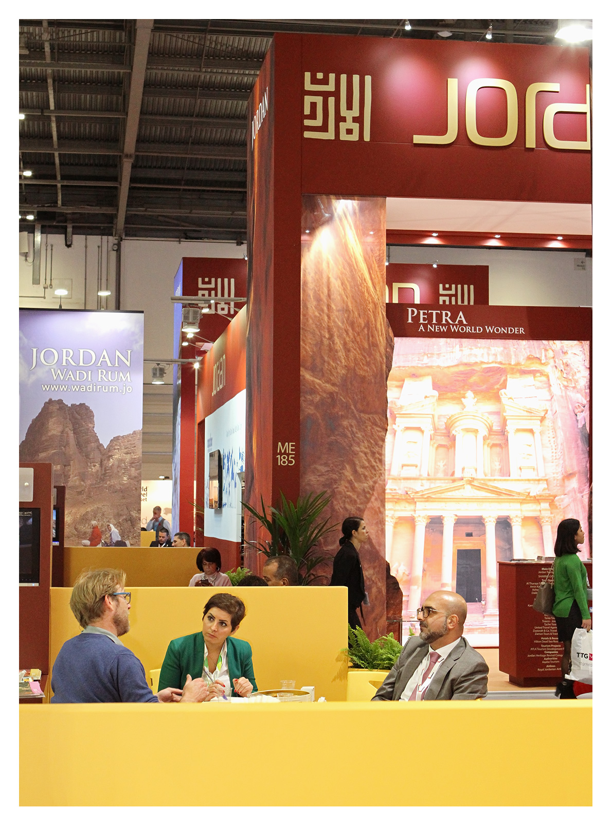 Exhibition photography: Delegates talking business at the Jordan stand, World Travel Market 2017, ExCel London