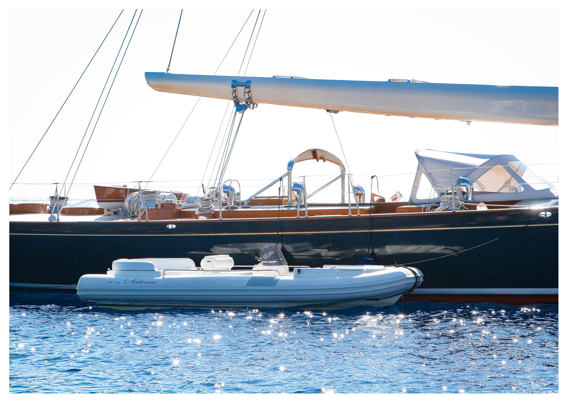 Yachting photography: Sailing yacht Antonisa with her tender anchored off Salina, Aeolian islands, Sicily