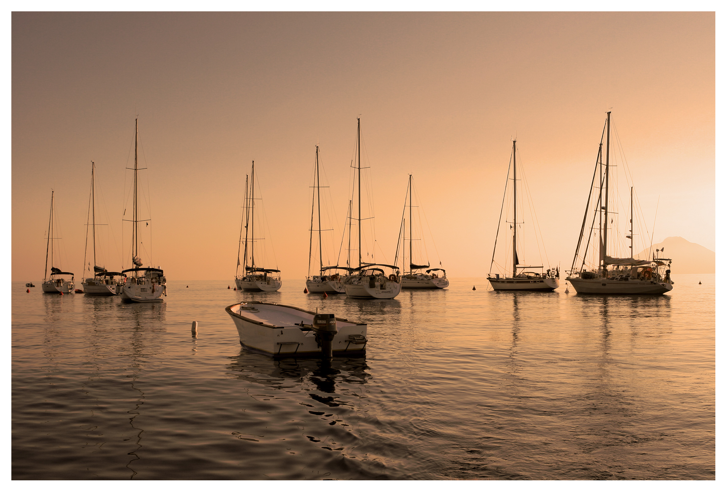 Yachting photography: Sailing yachts moored in the sunset off Panarea, Aeolian islands, Sicily