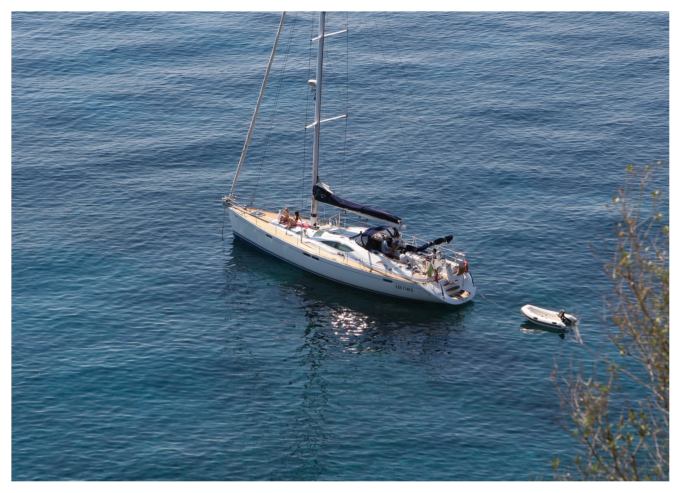Sailing yacht anchored in clear water off Capo Milazzese, Panarea, Aeolian islands, Sicily