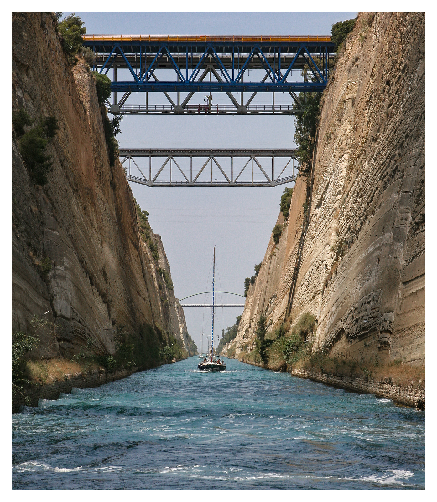 Yachting photography: A sailing yacht negotiating its way through the Corinth Canal, Greece